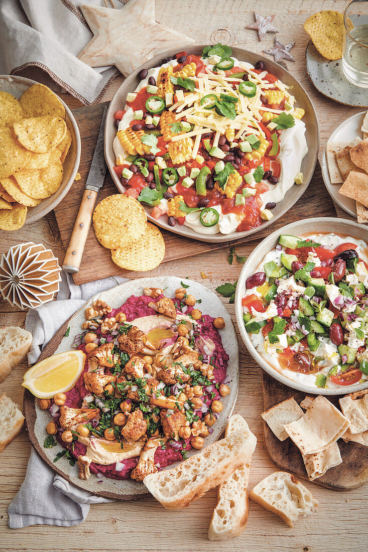 Loaded mexican dip, Loaded greek-style dip and Loaded hummus with spiced cauliflower dip