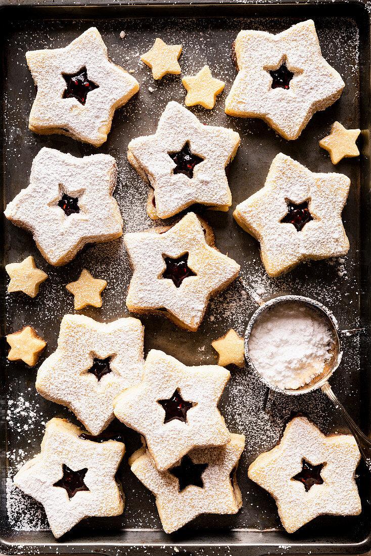 Linz gluten-free cookies with raspberry jam on a baking sheet