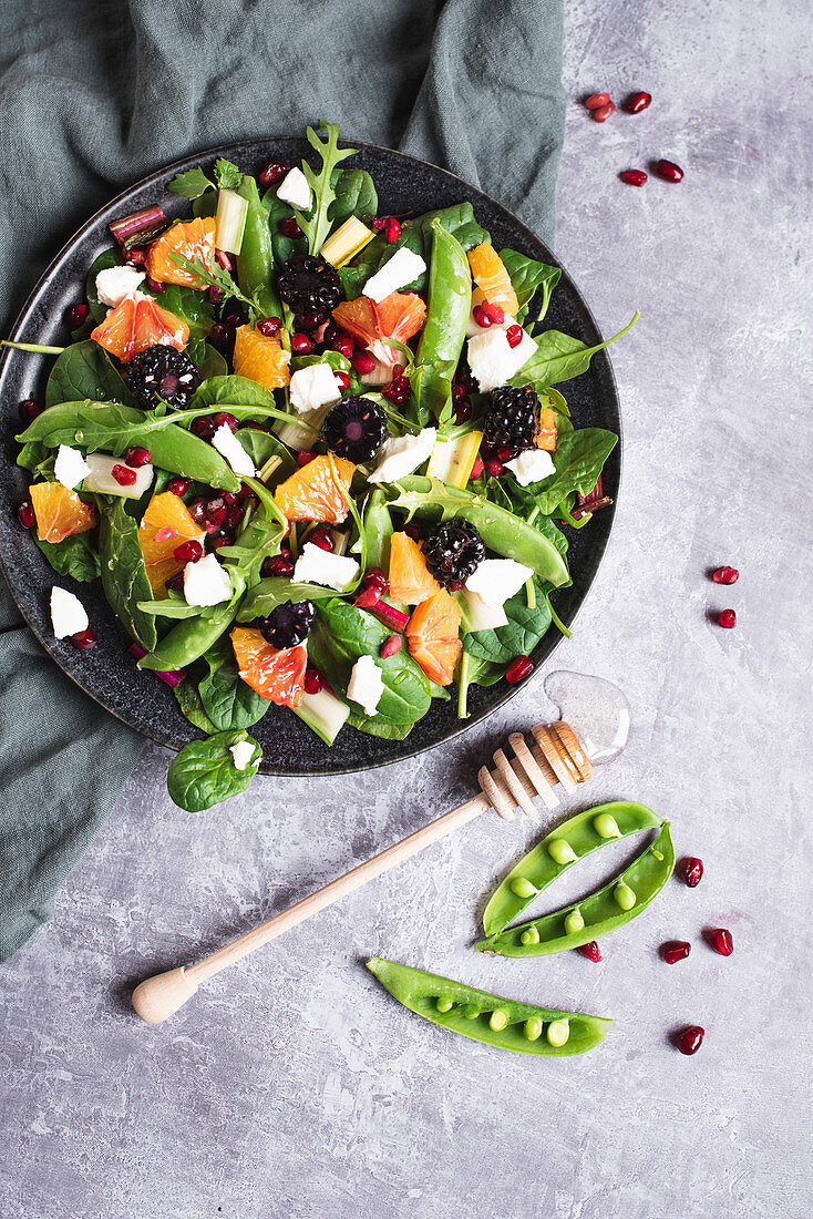 Winter salad with sugar snap peas, goat's cheese, blood oranges and blackberries