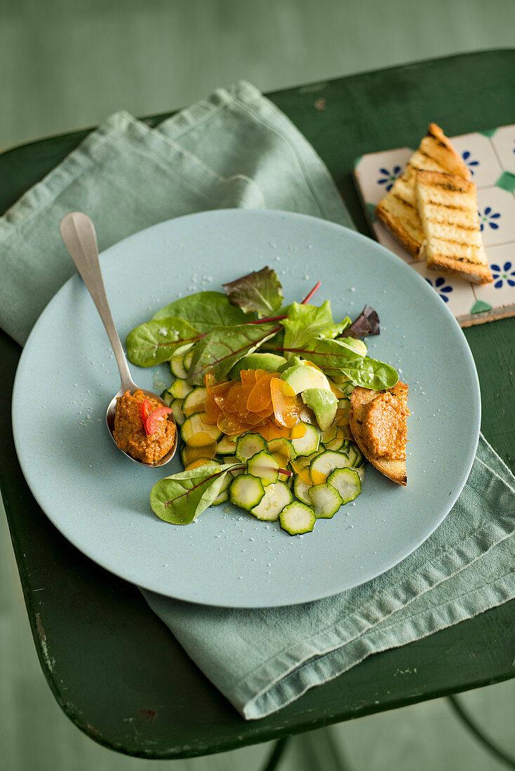 Courgette salad with avocado, bottarga and tomato pesto