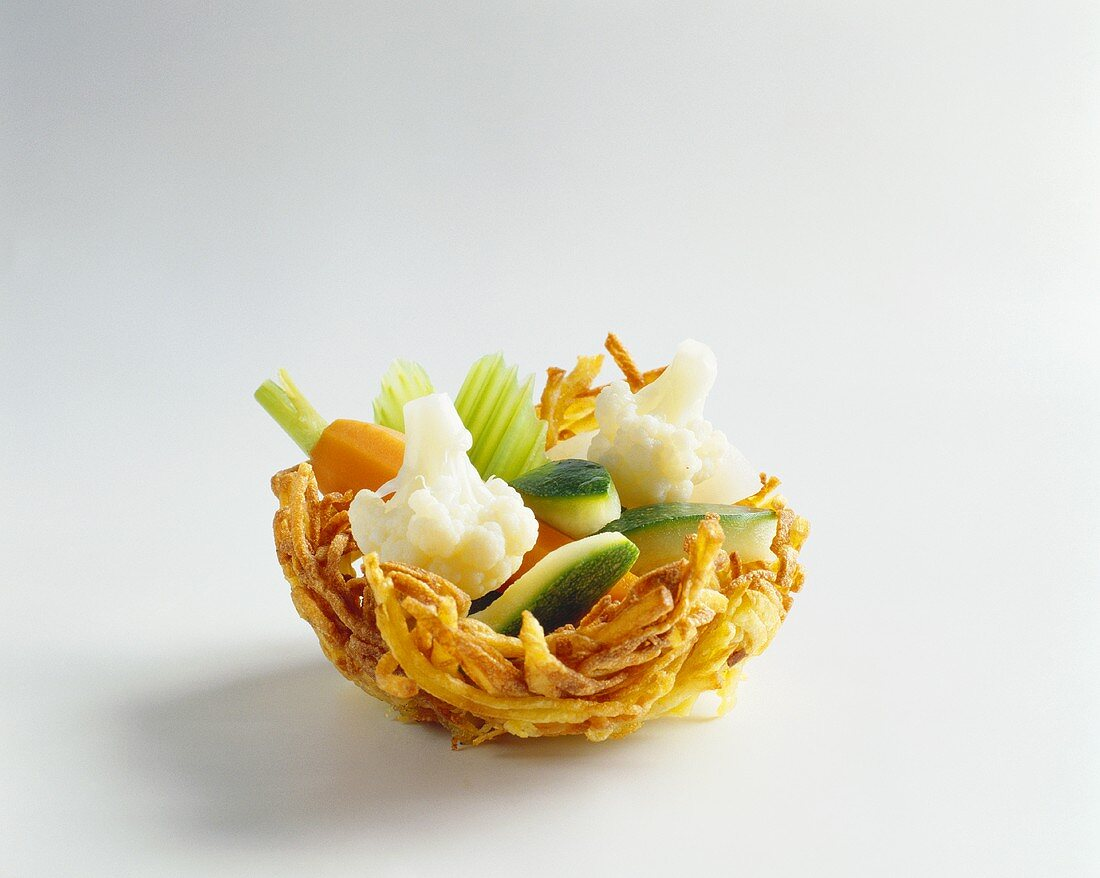 Potato nest with vegetable filling