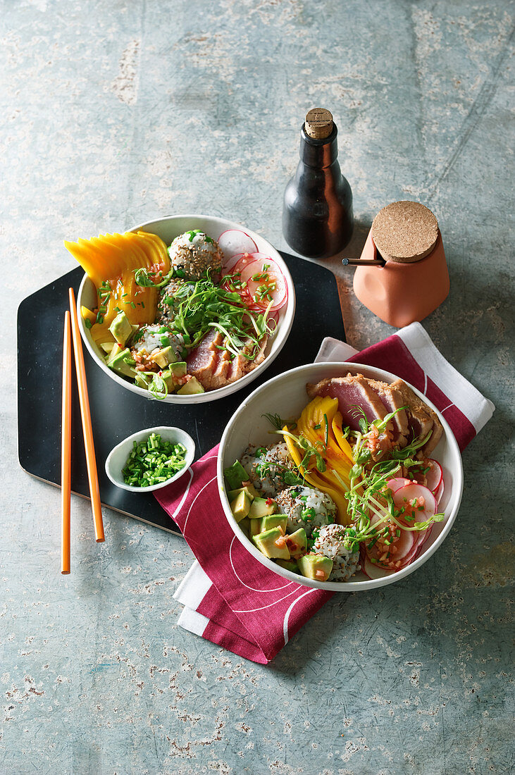 Sushi bowl with tuna, rice balls and avocado