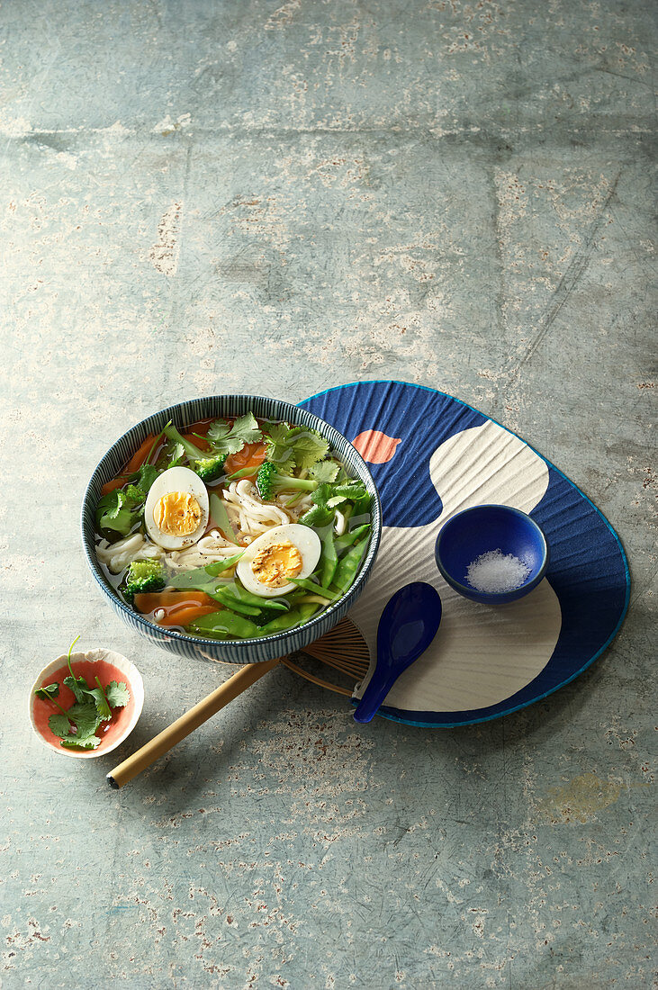 Udon noodle pot with vegetables and boiled eggs