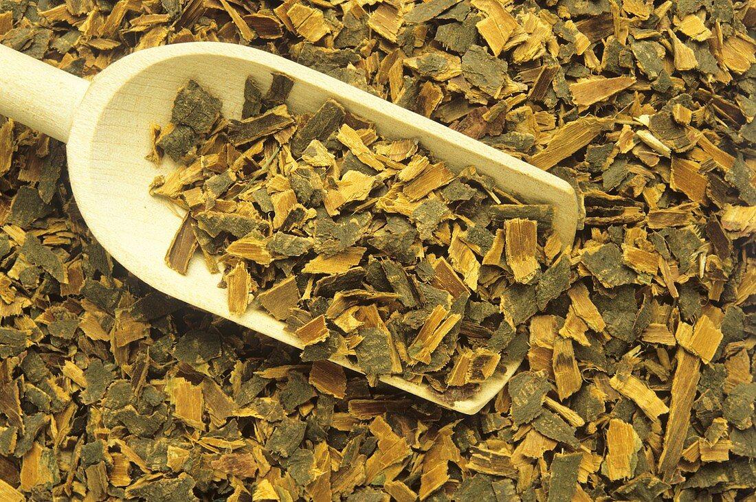 Wooden scoop with black alder bark (close-up)