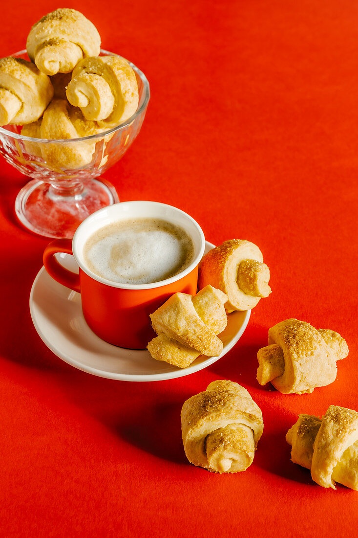 Sour cream and brown sugar crunchy croissant shaped cookies and coffee