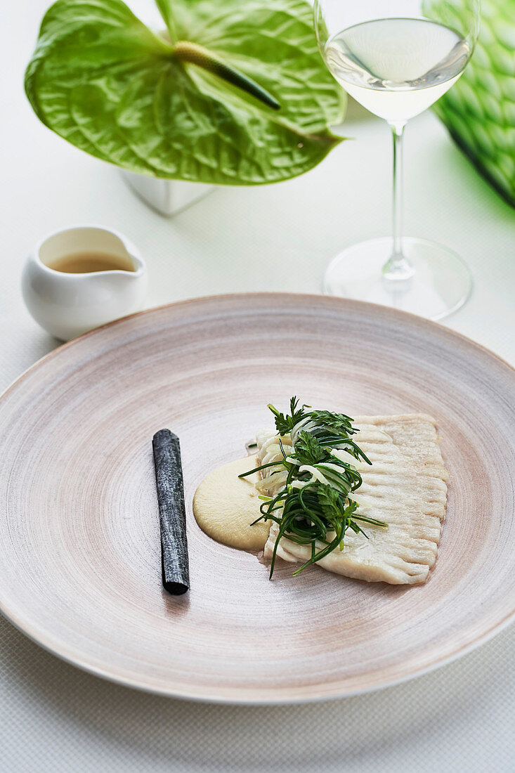 Skate wing with algae and razor clams