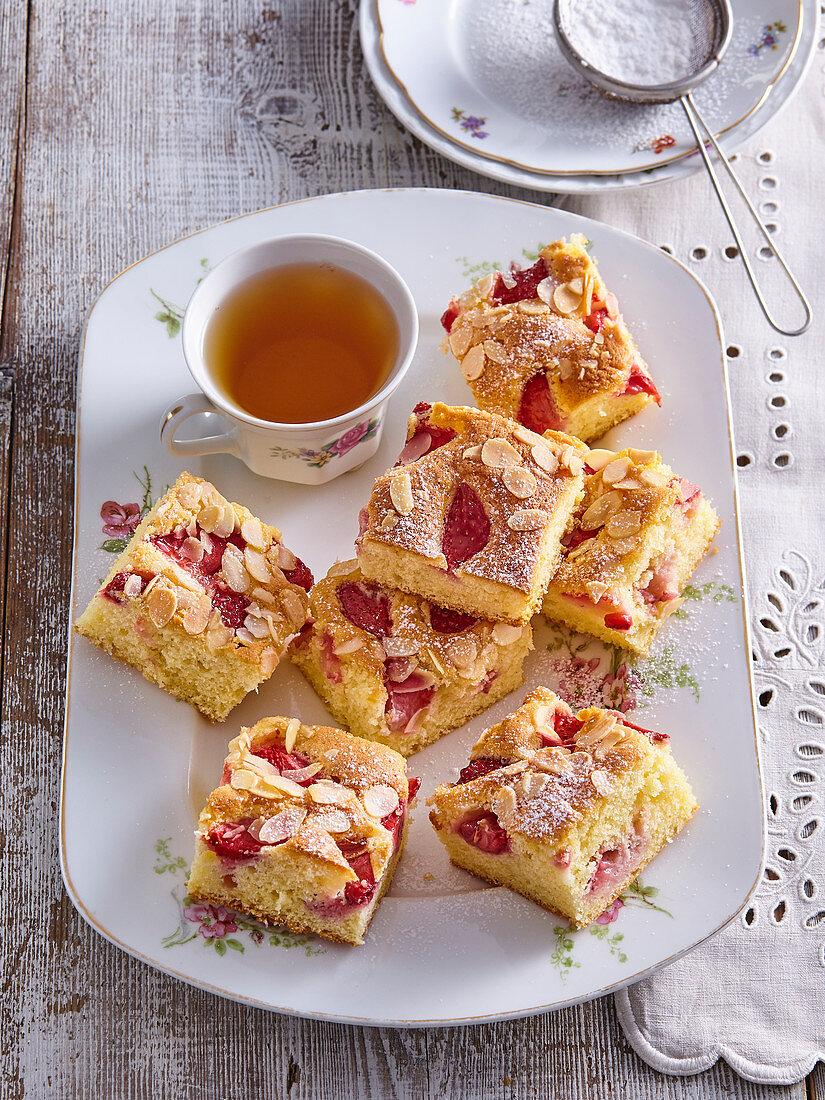 Strawberry sponge cake with almond flakes