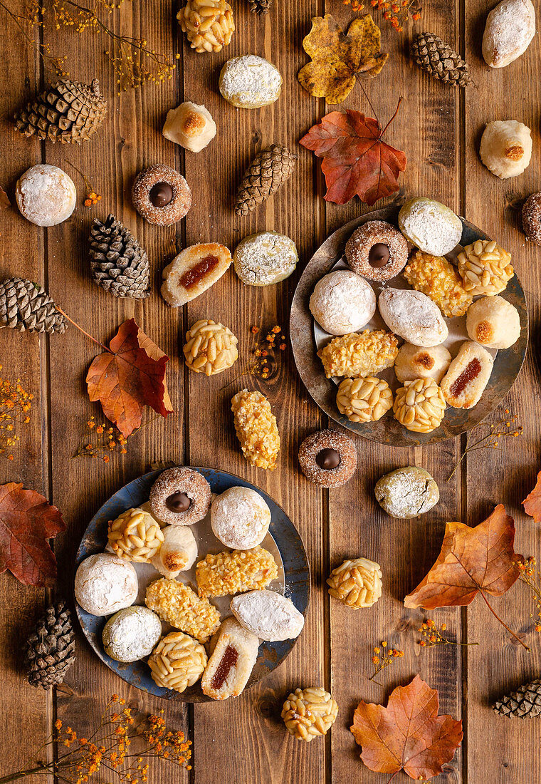 Panellets placed on table with dried autumn plants and cones for celebration of All Saints Day in Spain