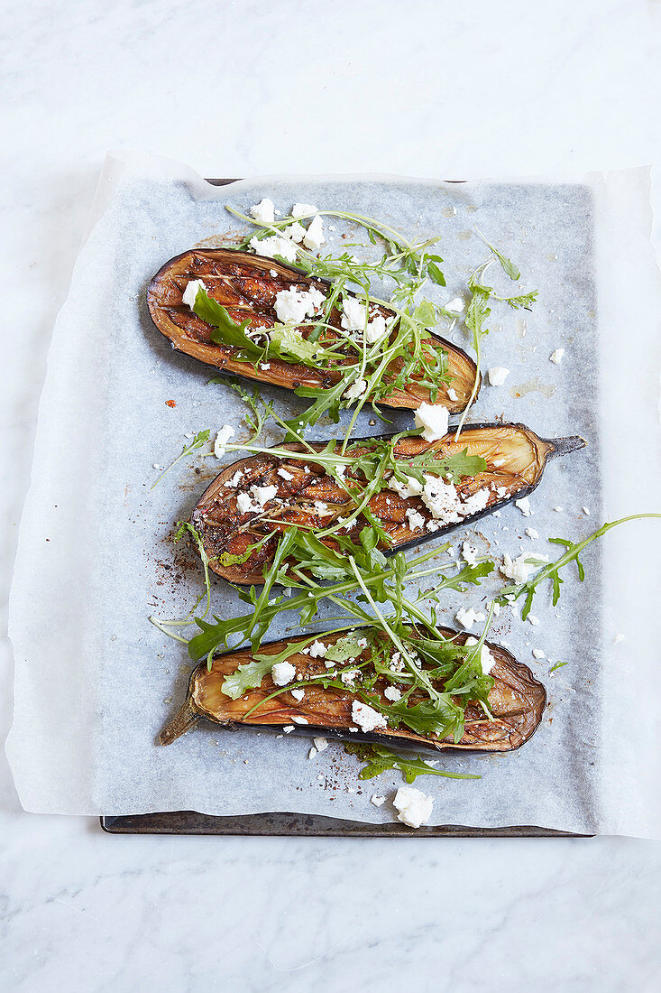 Oven-baked aubergines with rocket and feta cheese