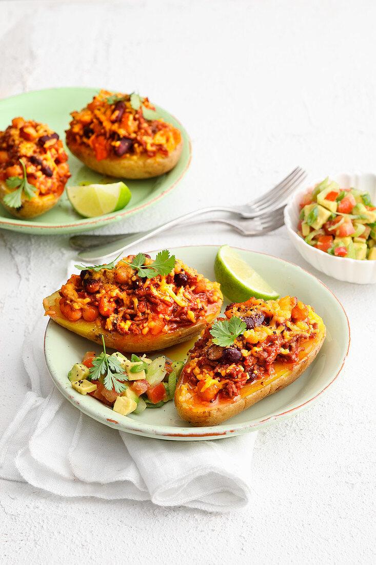 Chili-con-carne potatoes with avocado salad