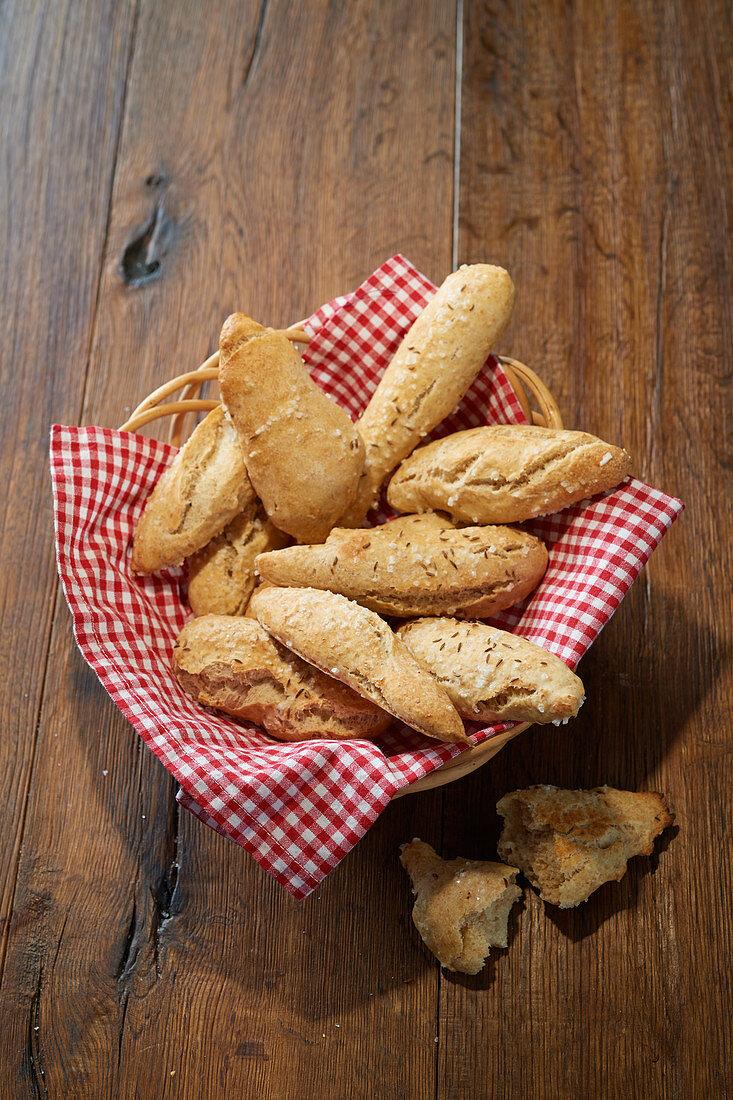 Roasted onion sticks in a bread basket