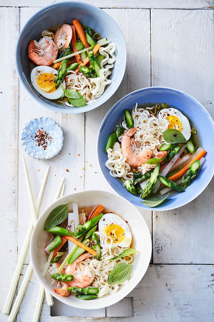 Asian asparagus bowl with egg, green asparagus and prawns