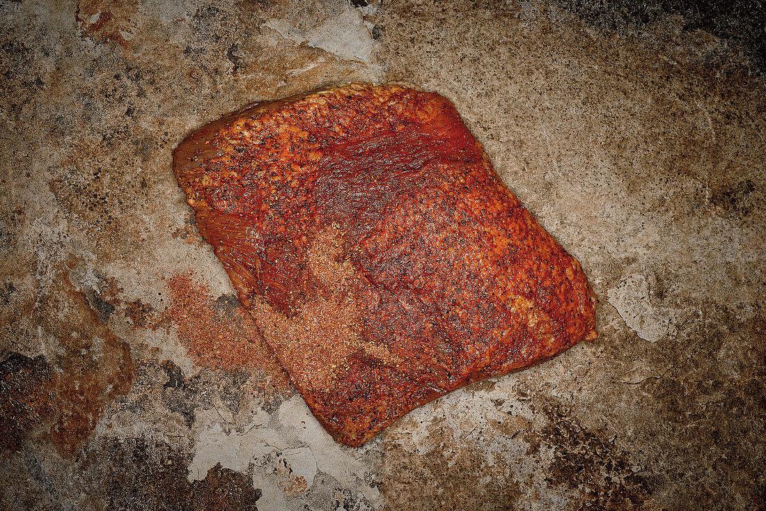 Raw beef brisket with jerk spice mix