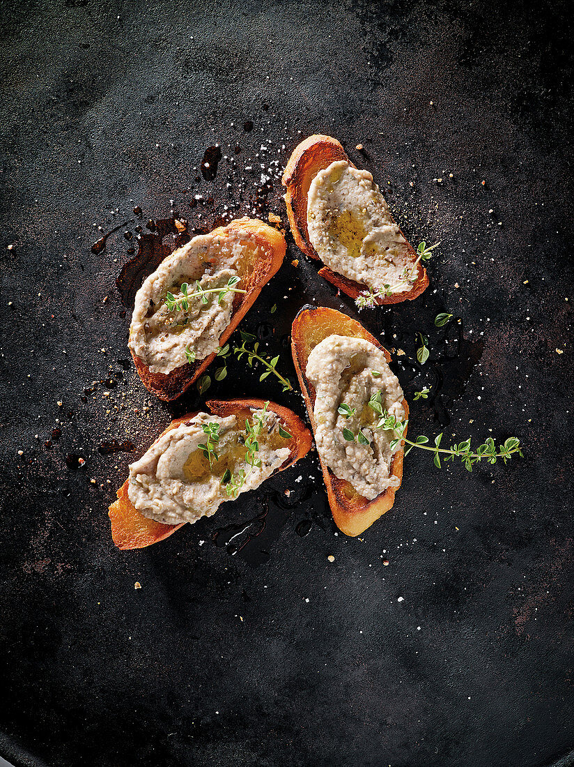 Cowboy bruschetta with white bean and olive tapenade