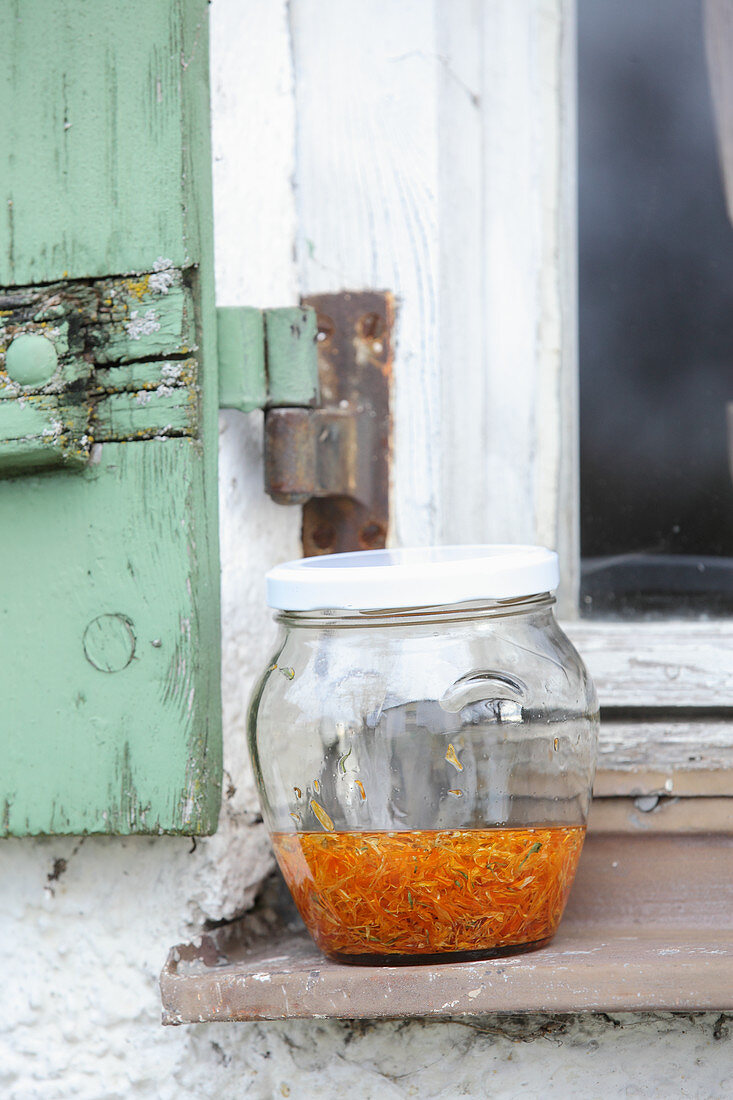 Marigold oil in a jar