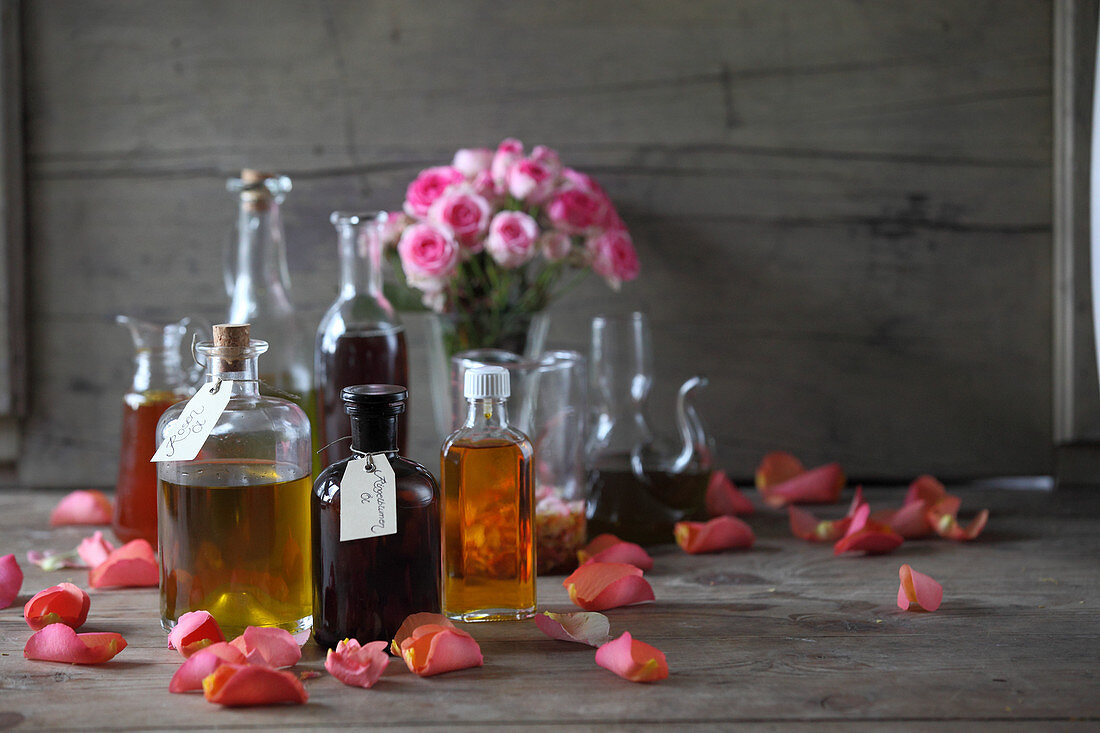 Various oils and oil extracts in glass bottles and carafes