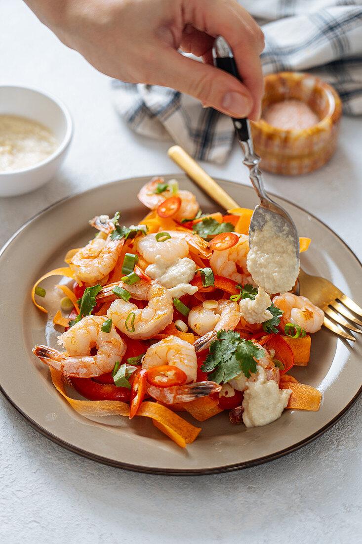 Tasty shrimp salad on table