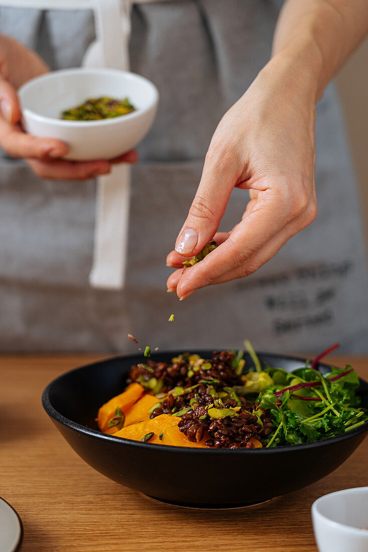 Adding seeds to healthy vegan dish