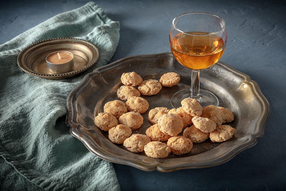 Amaretto liqueur and Amaretto cookies on a dark table