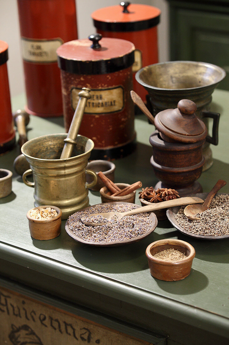 Herbs and spices with antique apothecary utensils