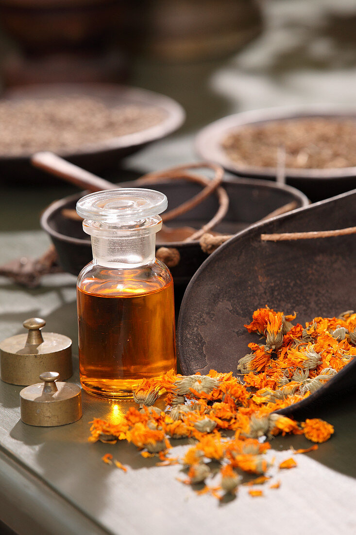 Marigold oil and dried marigold flowers
