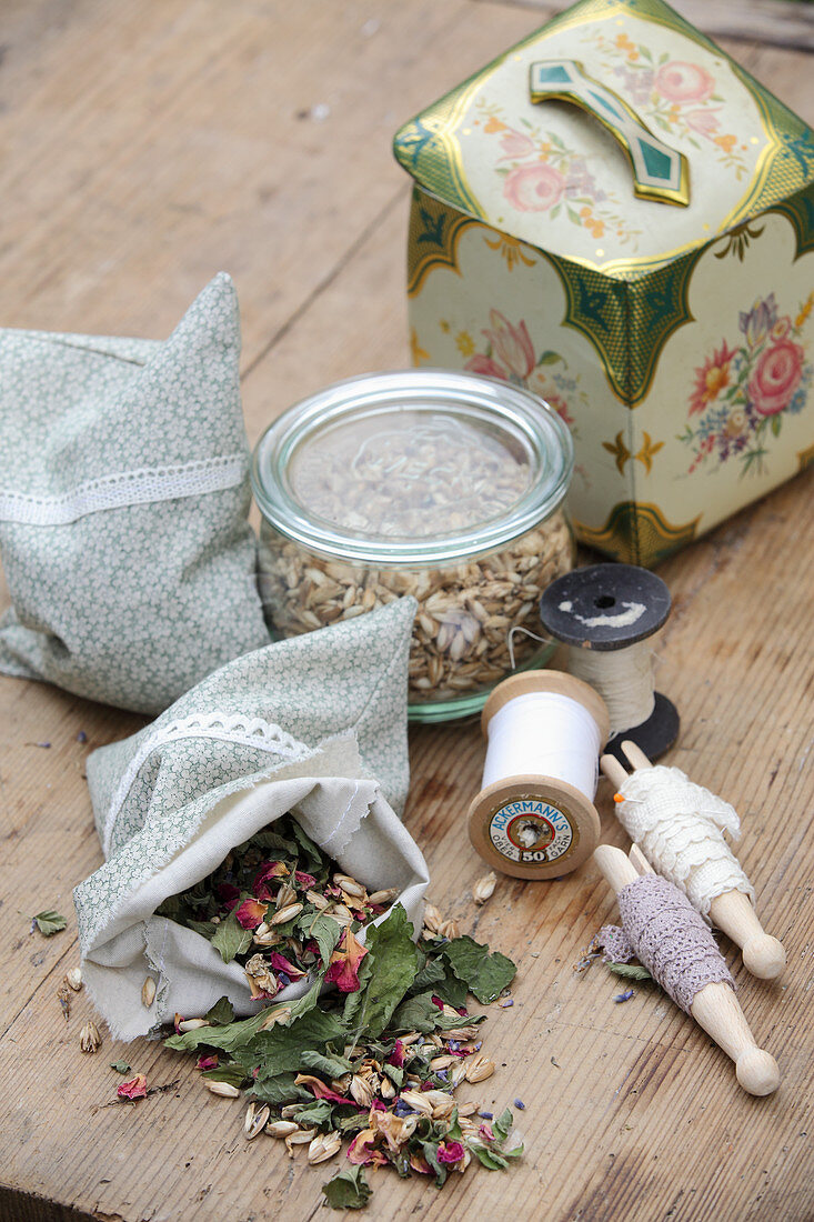 Cloth bag with dried herbs, flowers and spelt husks