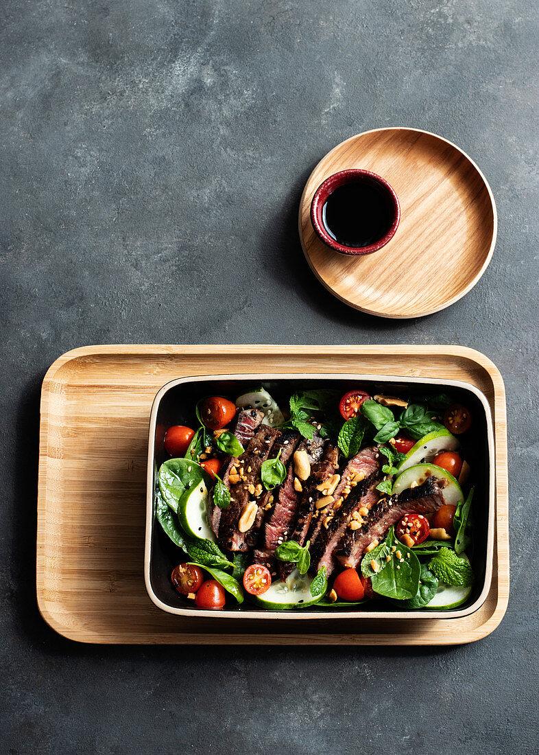 Beef thai salad on dark background