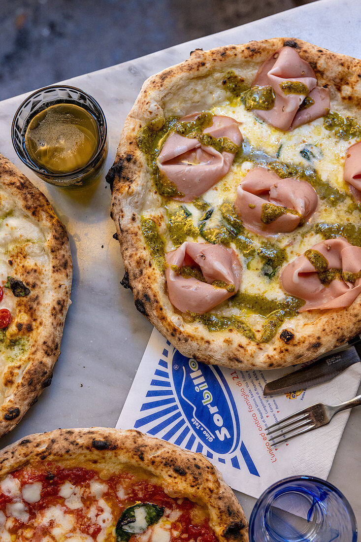 Pizza with mortadella and pistachios