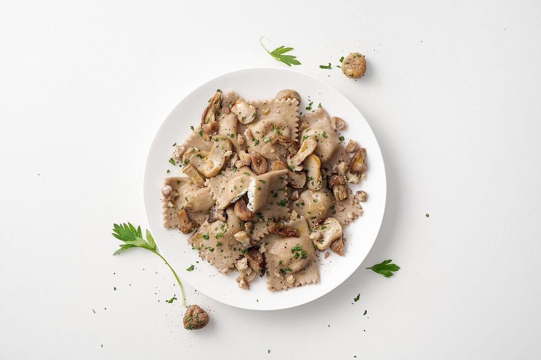 Chestnut and ricotta ravioli with porcini mushrooms and Parmesan