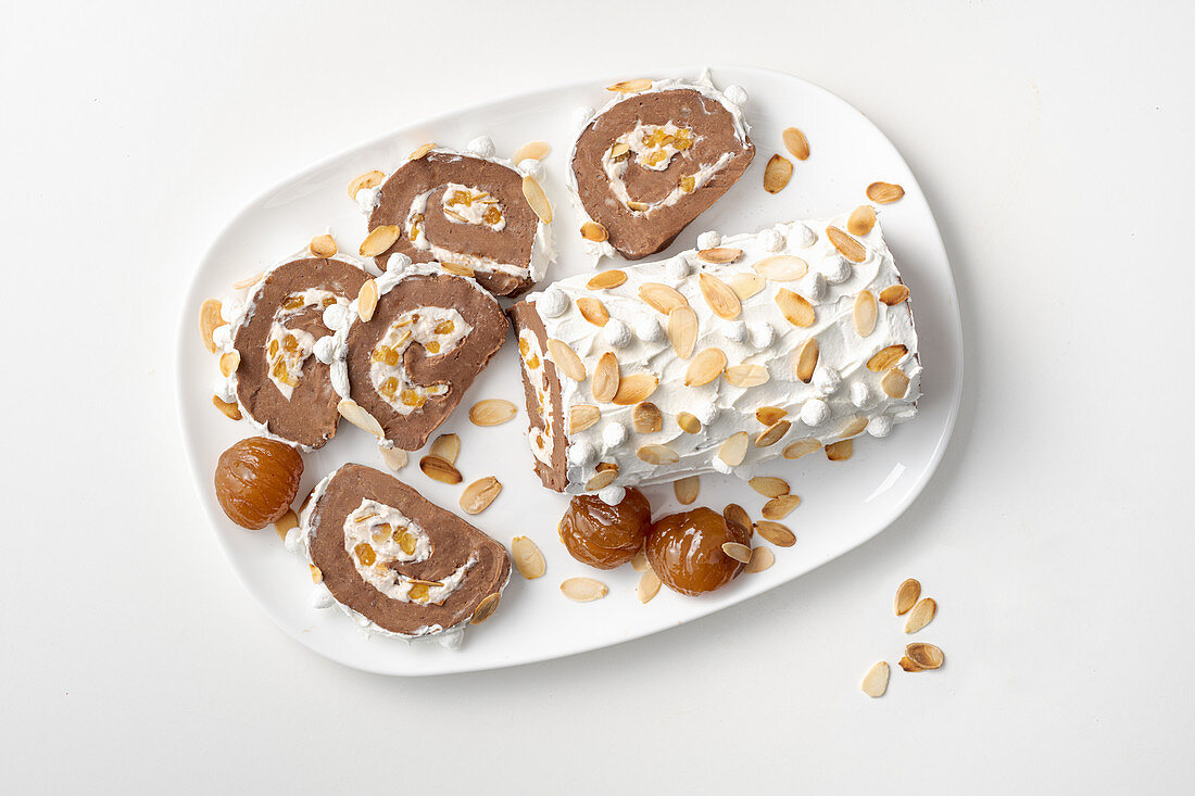 Chocolate and chestnut Swiss roll filled with cream and almonds