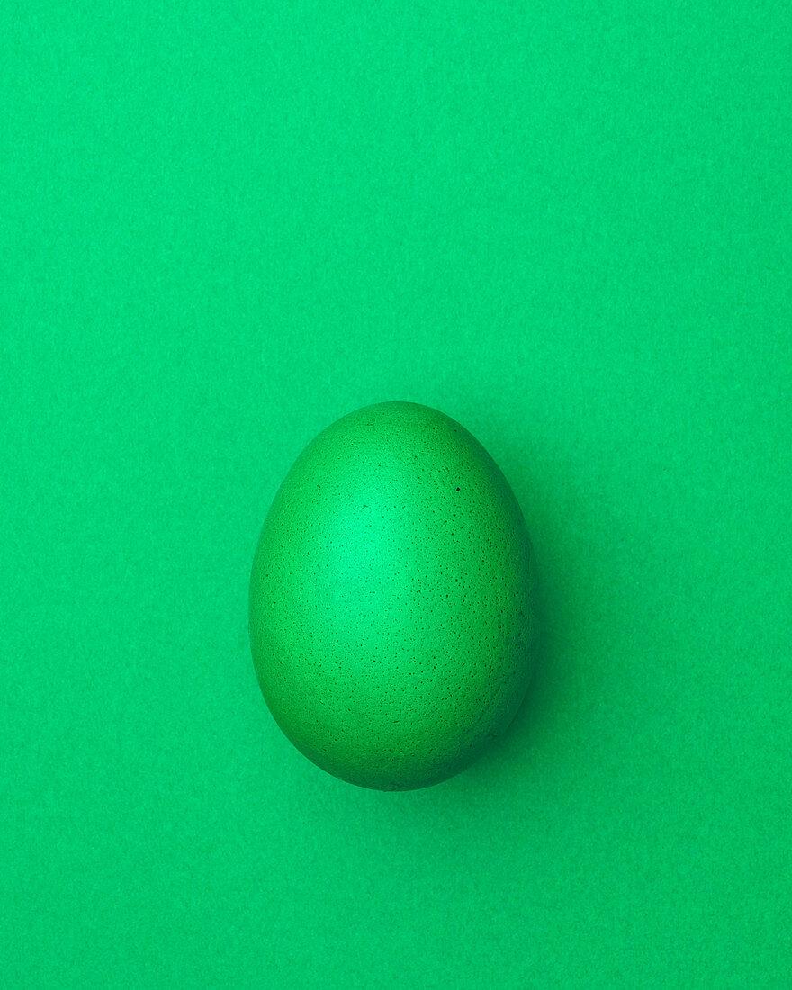 Light green Easter egg on a light green background