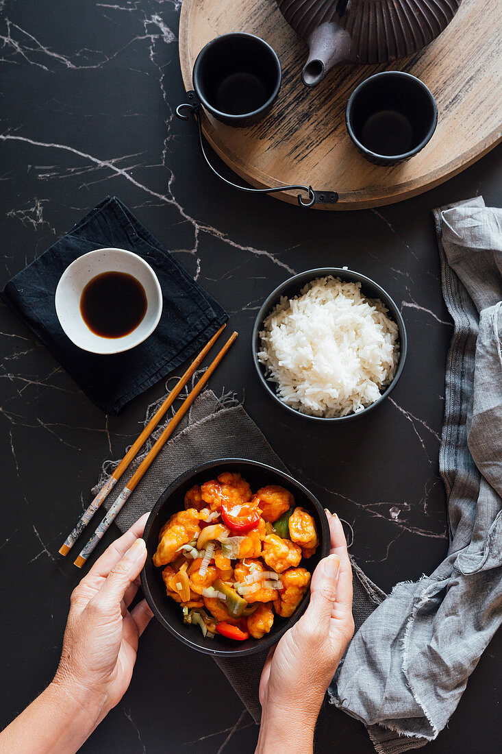 Asian chicken dish, rice and soy sauce arranged with tea set