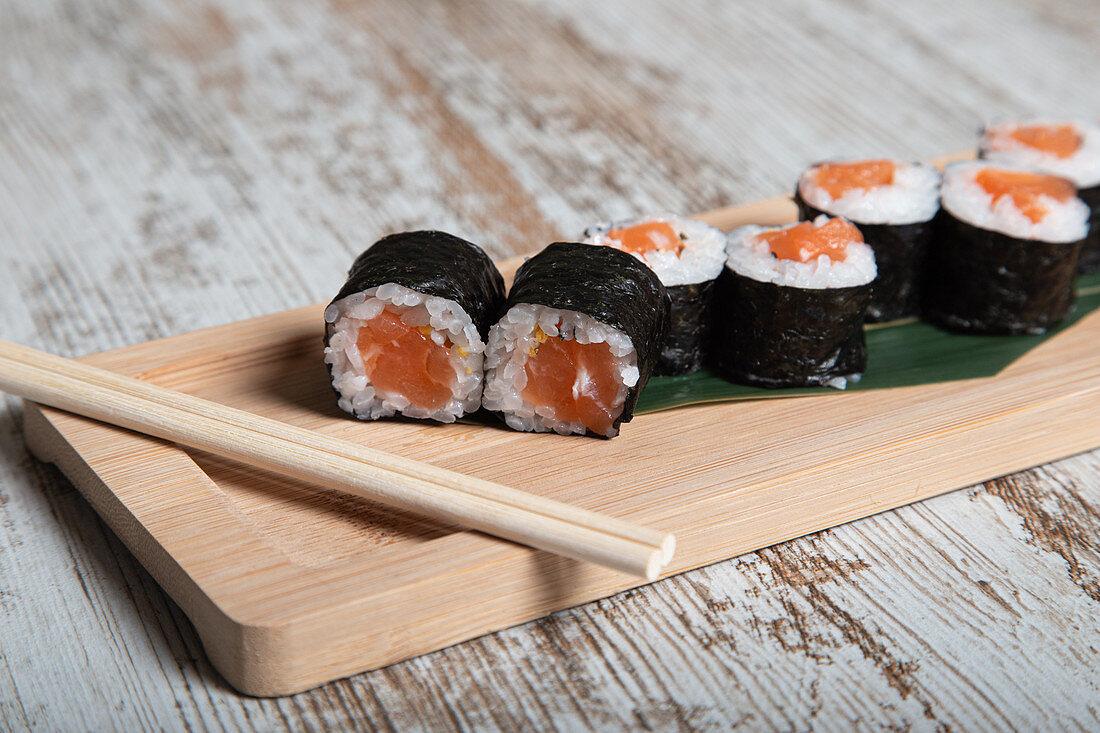 Set of Japanese hosomaki sushi rolls with fresh salmon fillet