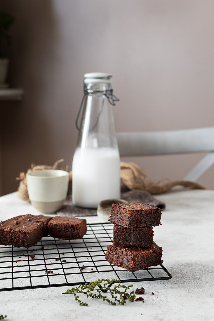 Stacked pieces of homemade brownie cake on metal grid