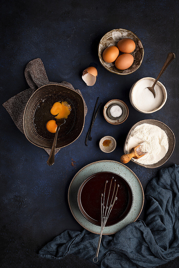 Ingredients in bowls with kitchen utensils for preparation of brownie cake