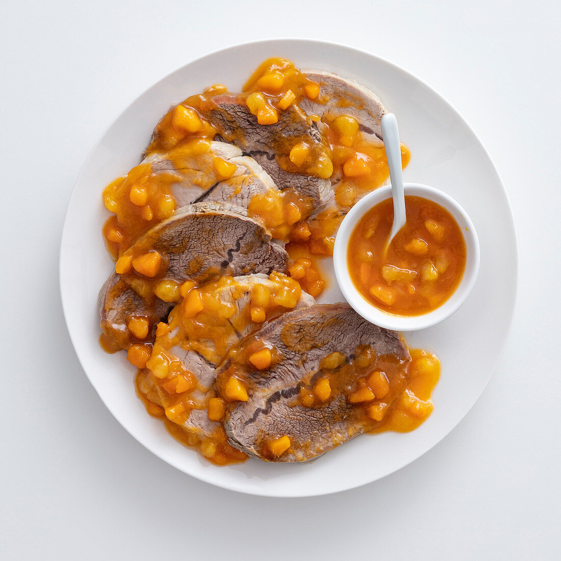 Boiled veal and beef with a pumpkin and pear chutney