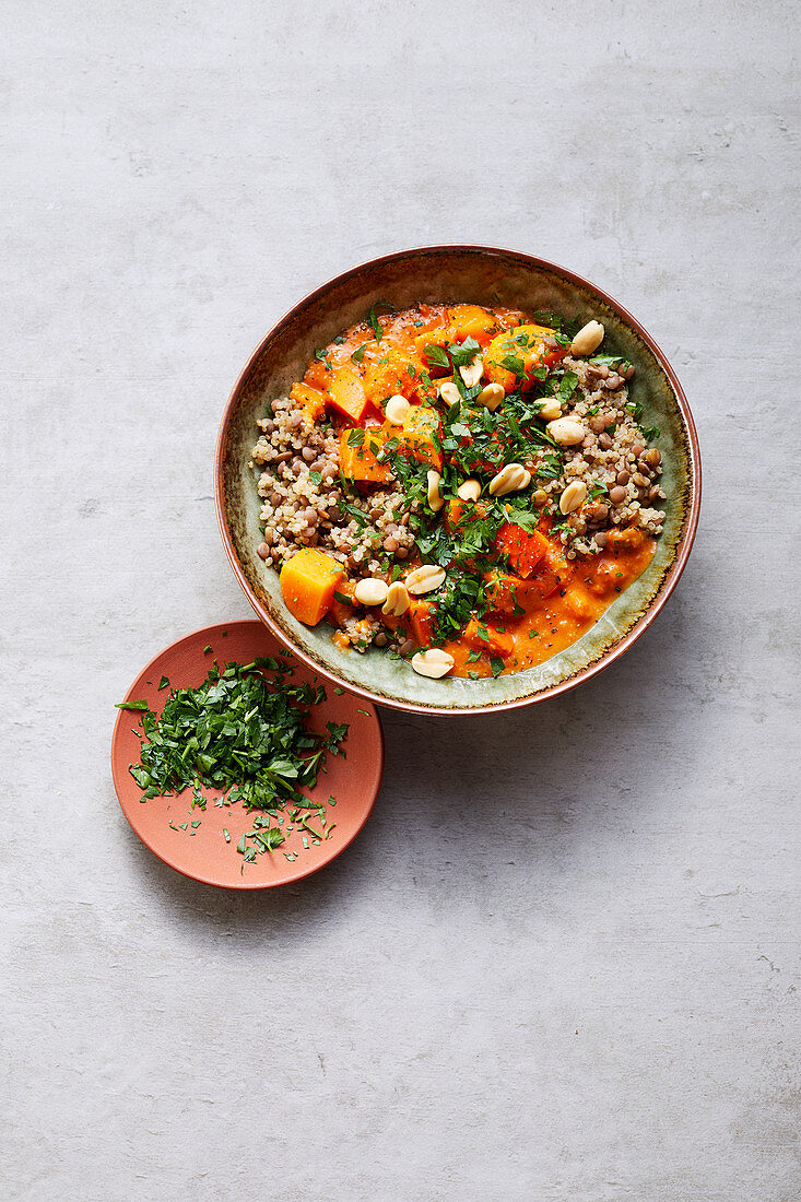 Pumpkin and tomato curry with a lentil and quinoa mix and peanuts