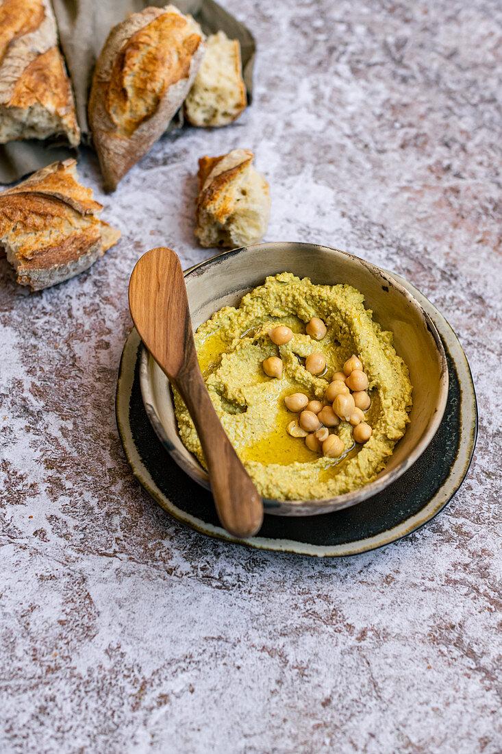 Vegan Avocado Hummus with torn baguette