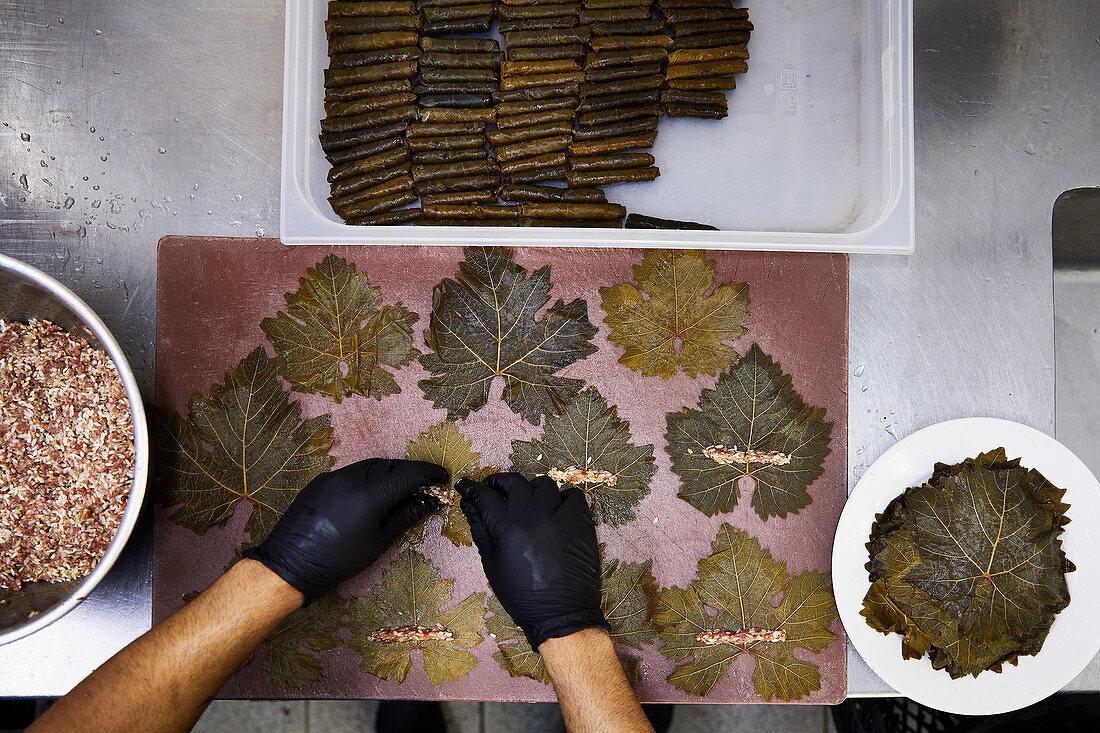 Vine leaves being stuffed