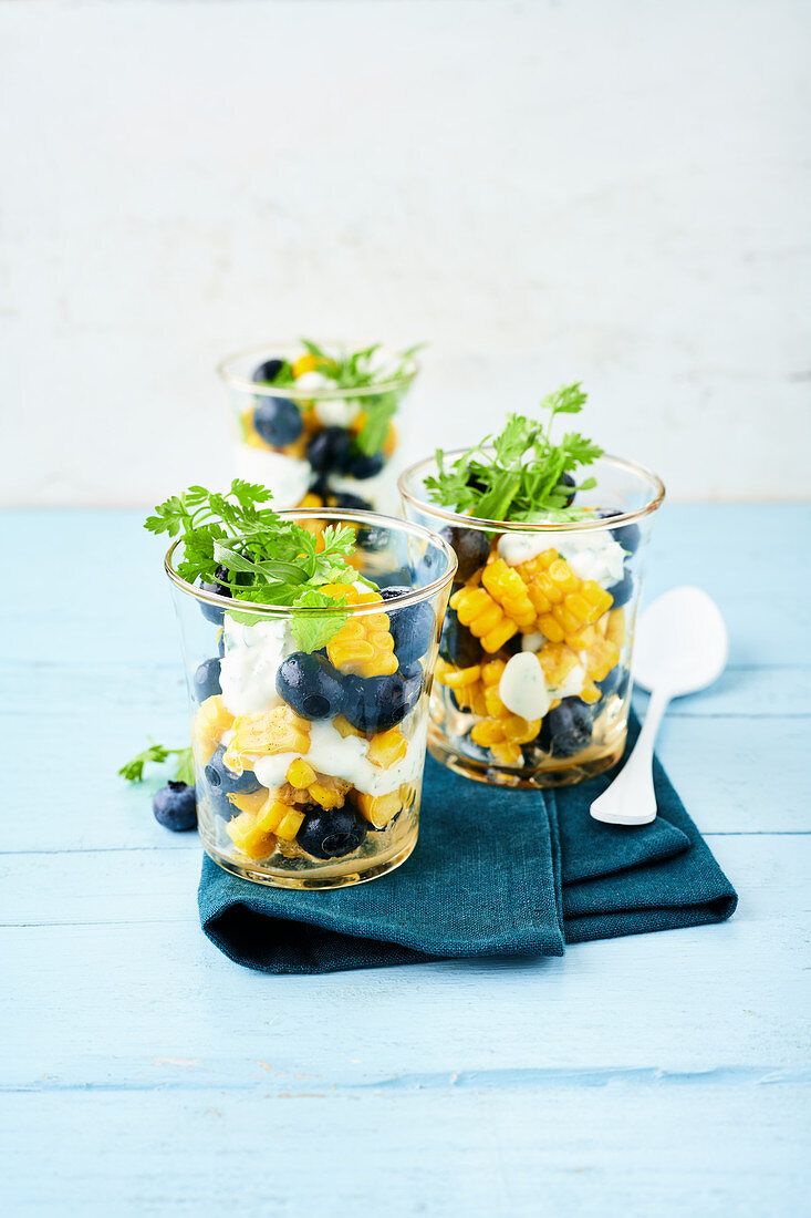 Sweet herb sour cream with blueberries and sweetcorn