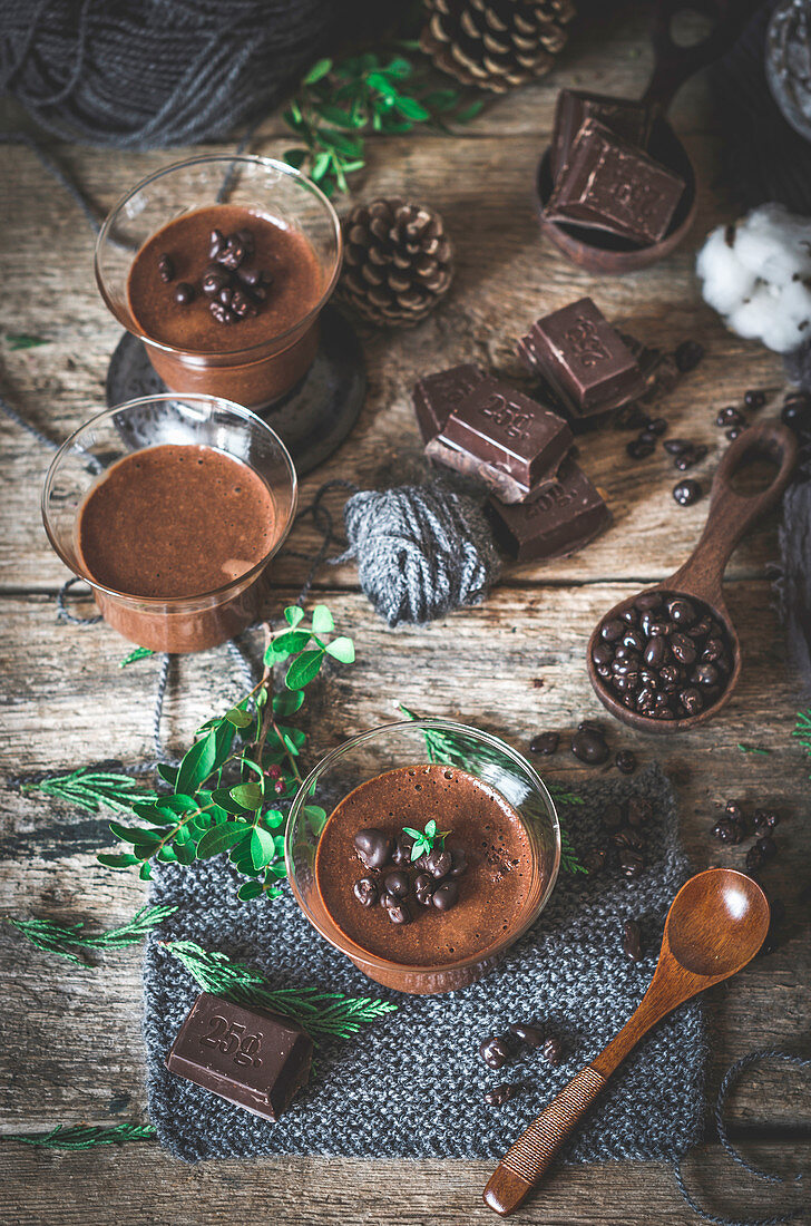 Chocolate mousse in glass bowls with various ingredients