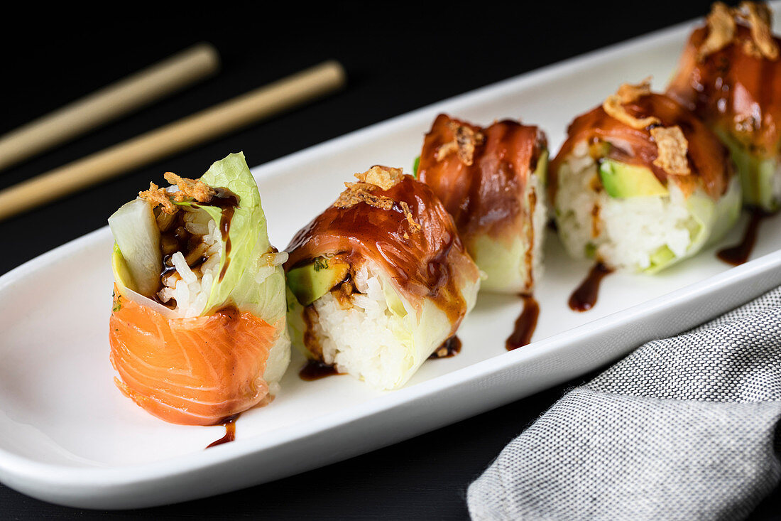 Rolls filled with fresh turnip and garnished with teriyaki sauce