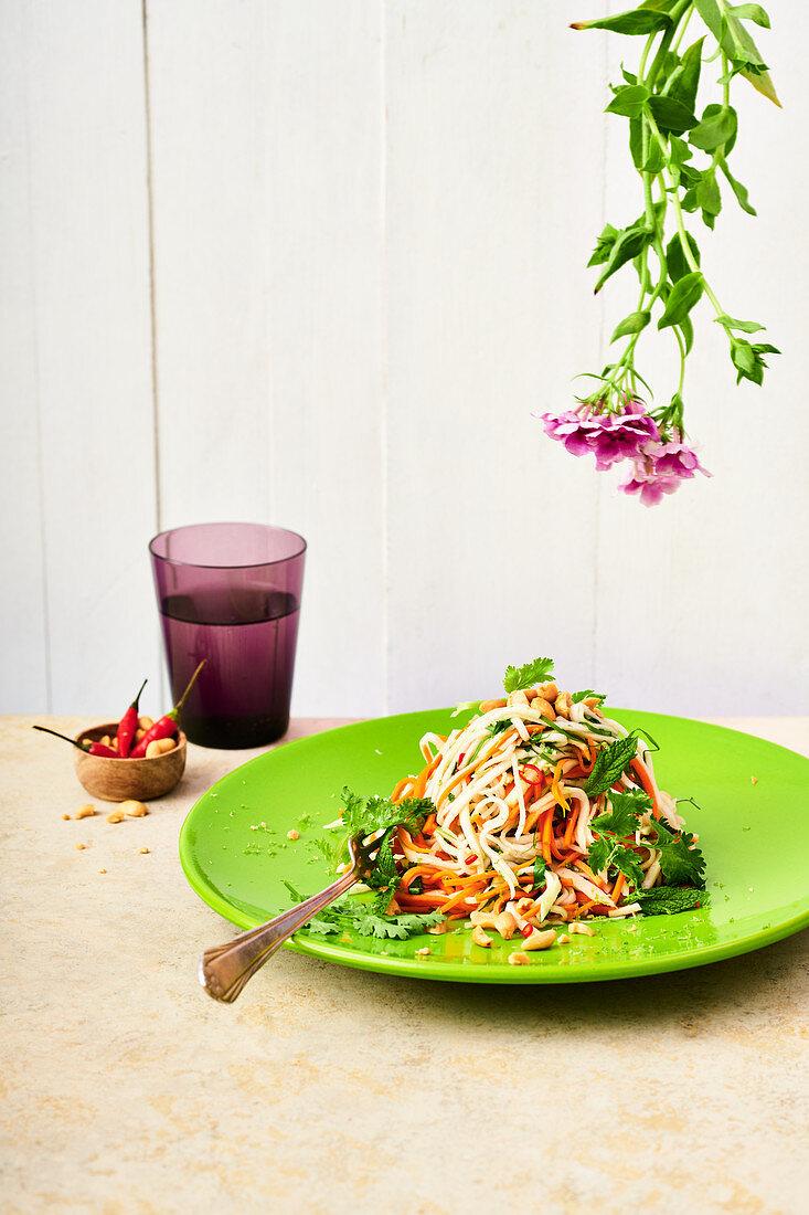 Vietnamese kohlrabi salad with papaya, peanuts and chilli