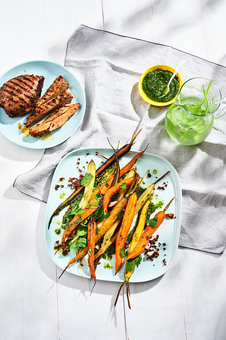 Carrot salad with colourful roasted carrots with carrot leaf pesto and pumpernickel crumbs