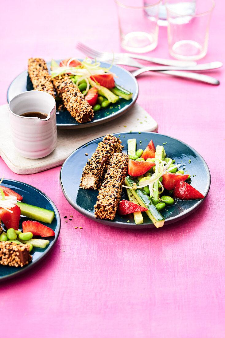 Edamame salad with tofu, strawberries and kafir lime leaves