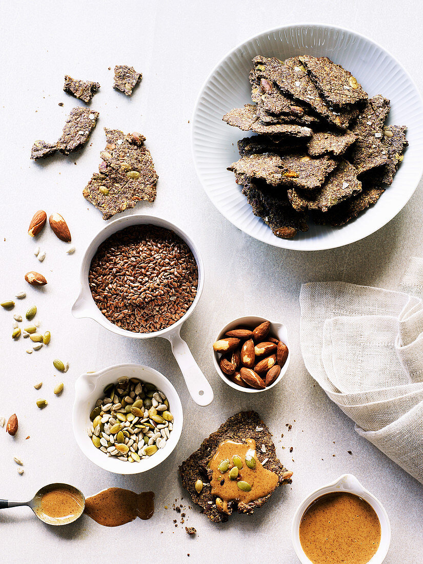 Gluten free flax seed cracker with almond butter, nuts and seeds