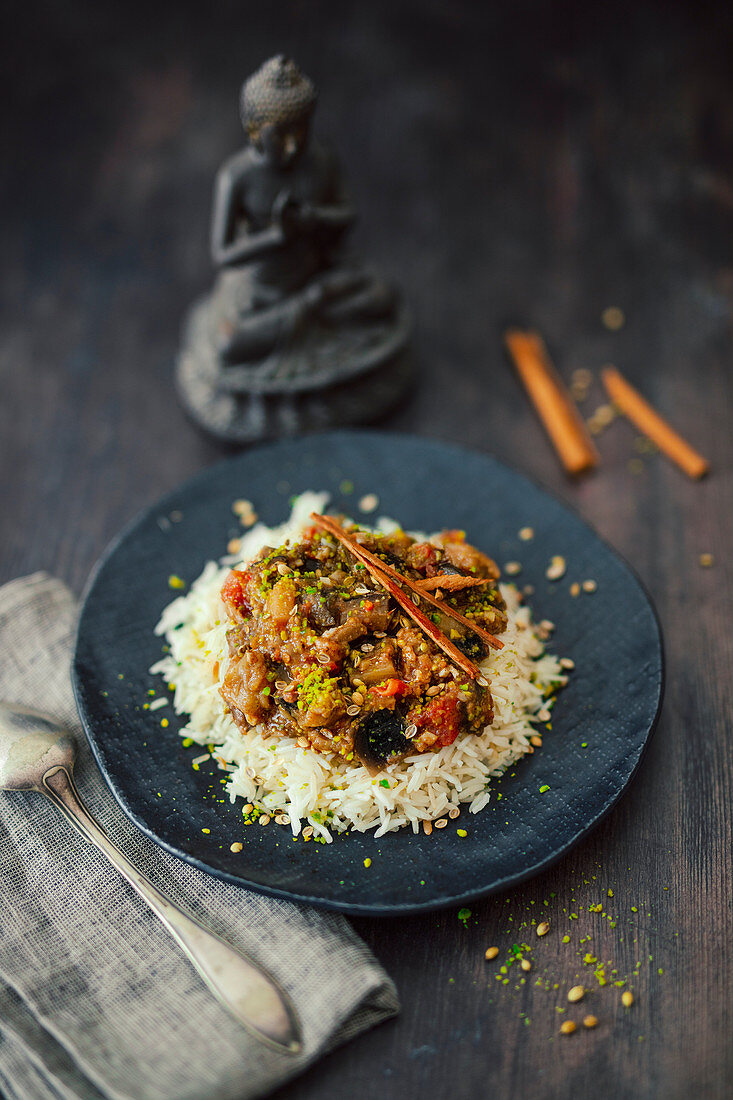Indian eggplant curry with coriander seeds, pistachios and cinnamon on rice
