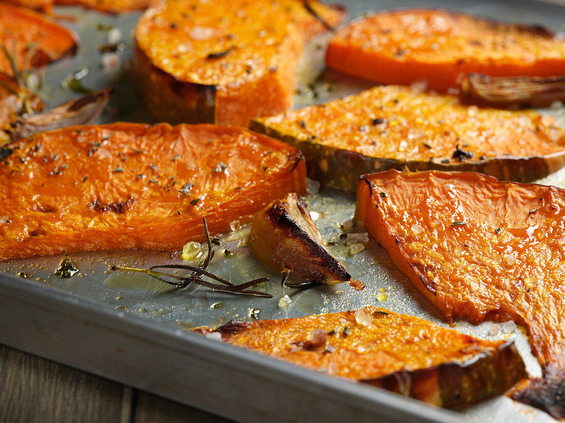Pumpkins wedges roasted with garlic and rosemary