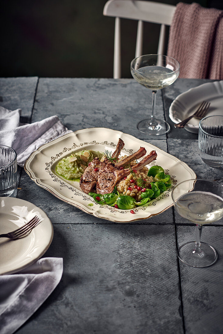 Lamb chops with barley risotto, fennel purée and Brussels sprout leaves