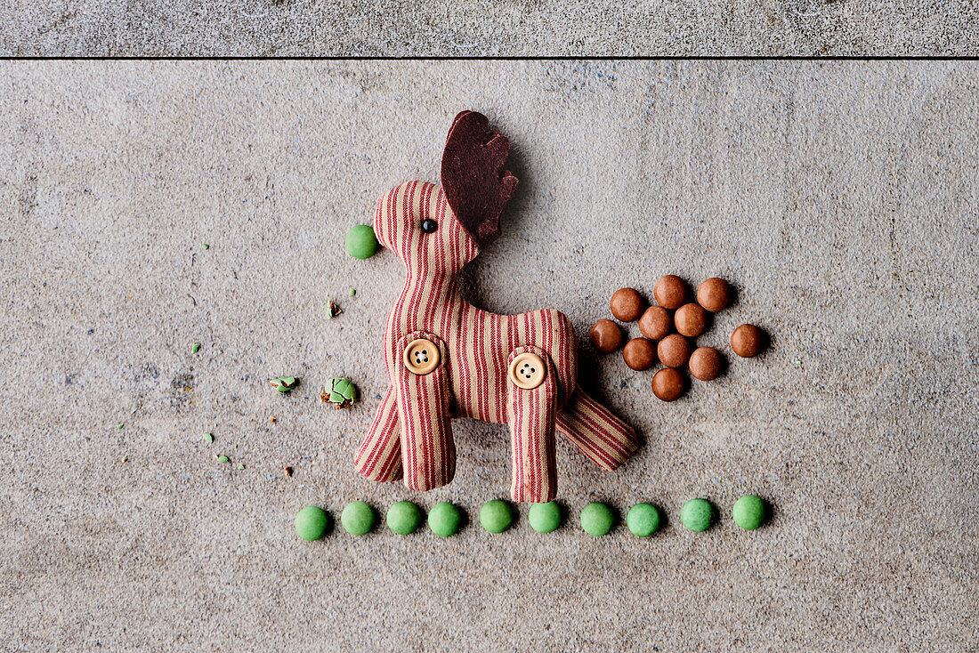 Smarties with a stuffed animal as decorations